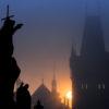Silhouette sculpture Prague's Charles Bridge at dawn